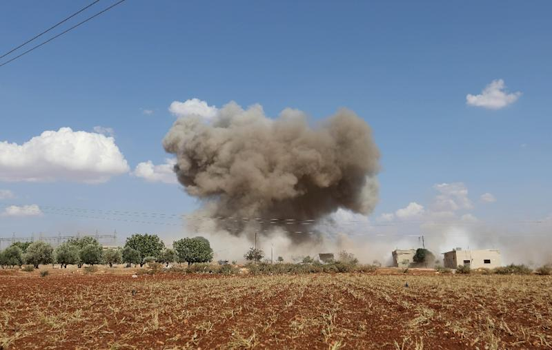 Smoke billows following Syrian government forces' bombardment around the village of Al-Muntar on the southern edges of rebel-held Idlib province (AFP Photo/OMAR HAJ KADOUR)