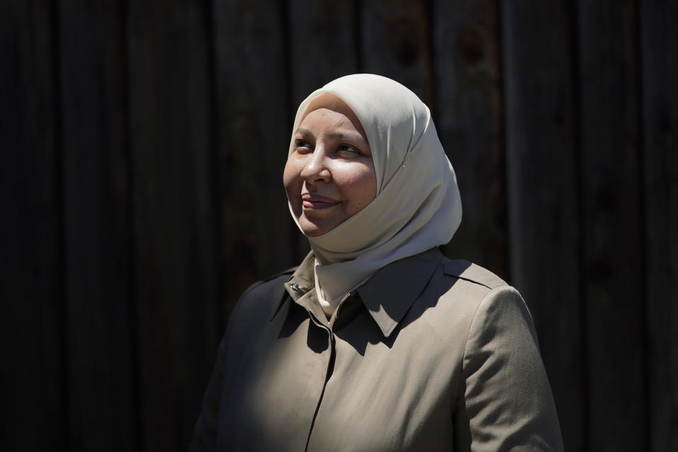 """Dr. Rania Awaad stands for a portrait at her home in Union City, Calif., Wednesday, June 23, 2021. """"Islamically, we understand that there is the theological rule of impermissibility of suicide so I'm not here to negate that,"""" Awaad says. However, she added, """"we don't know the state of a person when they reach this point in their life and we don't know their mental state in that moment. ... Only God can judge on this."""" (AP Photo/Jeff Chiu)"""