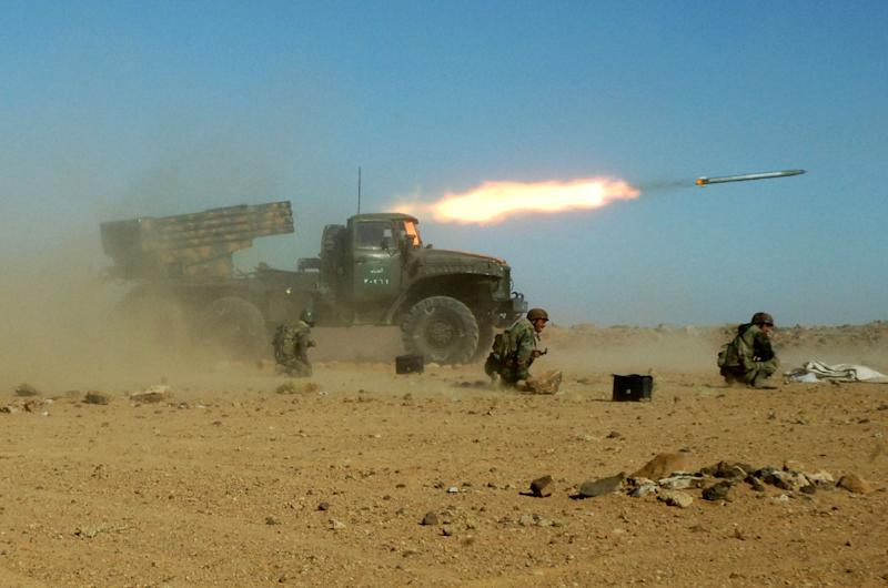 HOLD FOR STORY SYRIA ASSAD'S OPTIONS BY RYAN LUCAS - FILE - This Sunday, Dec. 4, 2011 photo provided by the Syrian official news agency SANA, shows Syrian soldiers kneeling next to a multiple rocket launcher as they fire missiles during a maneuver at an unknown location, in Syria. As the Obama administration tries to prod Congress into backing armed action against Syria, the regime in Damascus is hiding military hardware and shifting troops out of bases into civilian areas. (AP Photo/SANA, File)