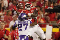 Minnesota Vikings cornerback Cameron Dantzler (27) breaks up a pass intended for Kansas City Chiefs wide receiver Daurice Fountain during the first half of an NFL football game Friday, Aug. 27, 2021, in Kansas City, Mo. (AP Photo/Charlie Riedel)