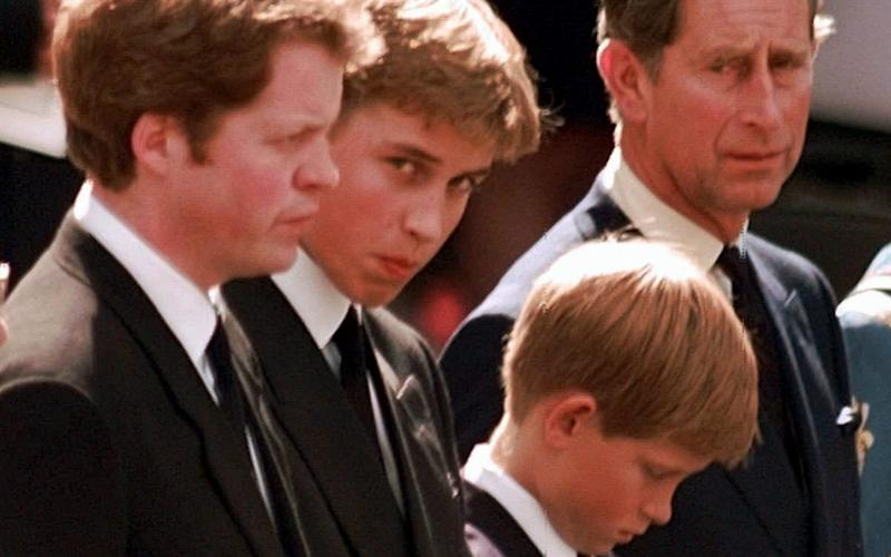 Prince Harry (third from left) bows as the hearse pull away from Westminster Abbey carrying the body of his mother Princess Diana. His father the Prince of Wales looks on after a funeral service in London, Saturday, Sept. 6, 1997, in London. At far left is the Viscount Spencer, Diana's brother and next to him Prince William - Credit: AP