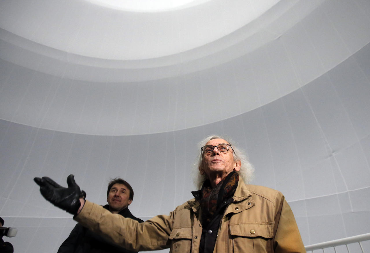 Bulgarian artist Christo gestures as he poses inside the installation 'Big Air Package' during the unveiling of the installation at the Gasometer in Oberhausen, Germany, Friday, March 15, 2013. Christo's latest monumental sculpture in the interior of the industrial monument can be seen from March 16 until Dec. 30, 2013. (AP Photo/Frank Augstein)