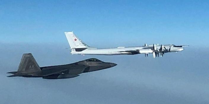 North American Aerospace Defense Command F-22 fighter aircraft, supported by E-3 airborne warning and control system and KC-135 refueler aircraft, intercepted two Russian Tu-95 bombers escorted by two Su-35 fighter aircraft