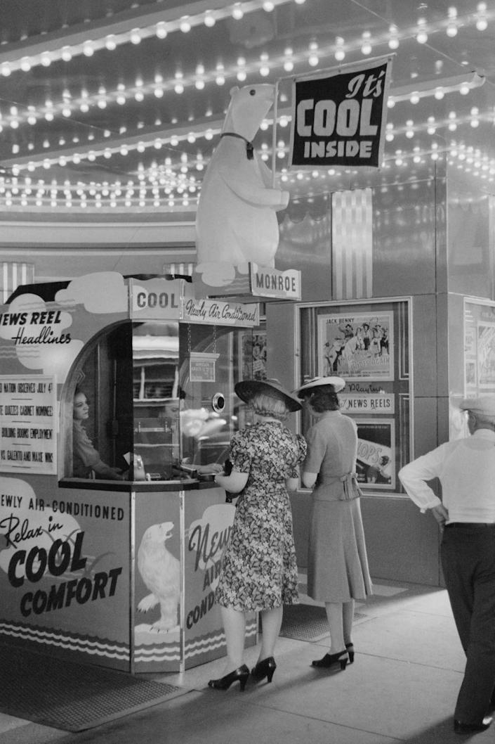 <p>Two women buying tickets at a movie theater in 1940.<br></p>