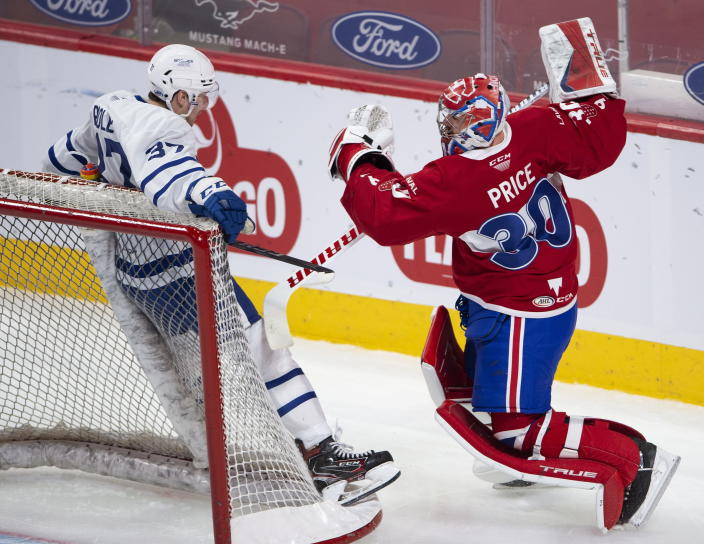 Laval Rocket goaltender Carey Price, right, collides with Toronto Marlies' Scott Pooley during first-period American Hockey League action in Montreal, Monday, May 17, 2021. Price and Brendan Gallagher are on a one-game conditioning loan to the Rocket before their playoff series against the Toronto Maple Leafs. (Ryan Remiorz/The Canadian Press via AP)