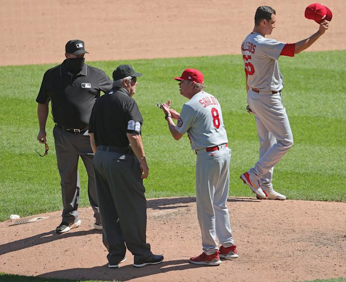 CHICAGO, ILLINOIS - MAY 26: Manager Mike Shildt #8 of the St. Louis Cardinals argues with umpire Joe West #22 after being ejected from the game in the 7th inning against the Chicago White Sox at Guaranteed Rate Field on May 26, 2021 in Chicago, Illinois. The Cardinals defeated the White Sox 4-0. (Photo by Jonathan Daniel/Getty Images)