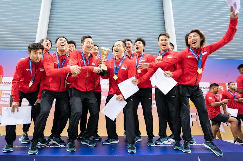 The Singapore national water polo team celebrate winning their first FINA Water Polo Challengers Cup title. (PHOTO: Colin Ong/Singapore Swimming Association)