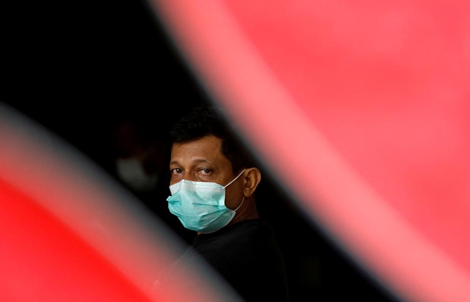 A migrant worker at a dormitory, amid the COVID-19 outbreak, here on 27 April, 2020. (PHOTO: Reuters)