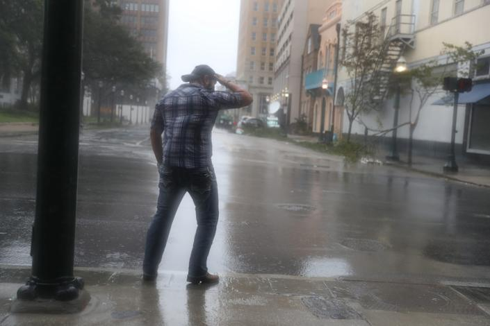 """Steven Jagnandan braces himself against winds and rain from Hurricane Sally as it passes through the area on September 16, 2020 in Mobile, Alabama. <p class=""""copyright"""">Joe Raedle/Getty</p>"""