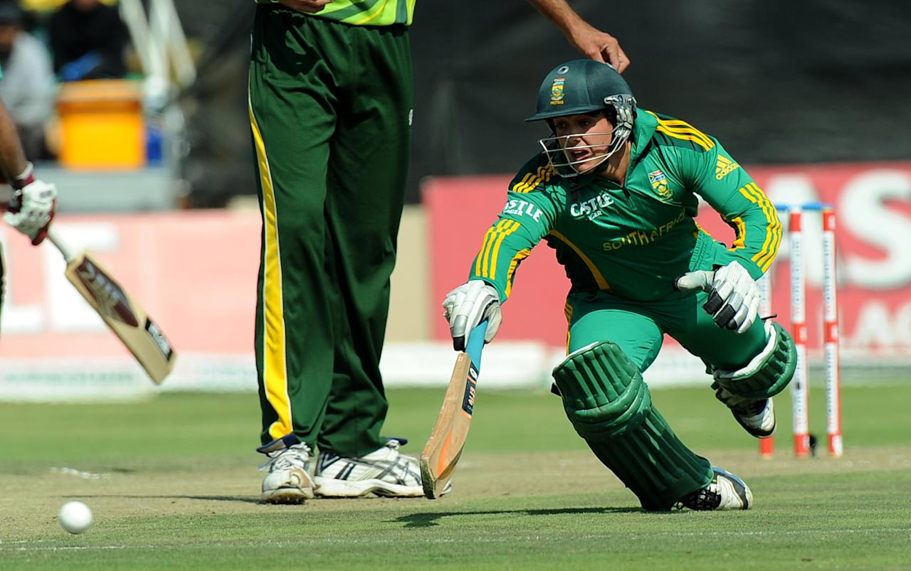 South Africa cricketer Quinton de Kock makes a safe dive during the fifth and final One-Day Internationals (ODI) cricket match between South Africa and Pakistan in Benoni at Willowmoore Park on March 24, 2013. Pakistan finished the innings on 205 all out. AFP PHOTO / ALEXANDER JOE        (Photo credit should read ALEXANDER JOE/AFP/Getty Images)