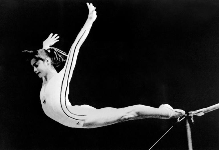 """Romanian gymnast Nadia Comaneci made history at the 1976 Montreal Olympics with the first-ever """"perfect 10"""" for her uneven bars routine"""