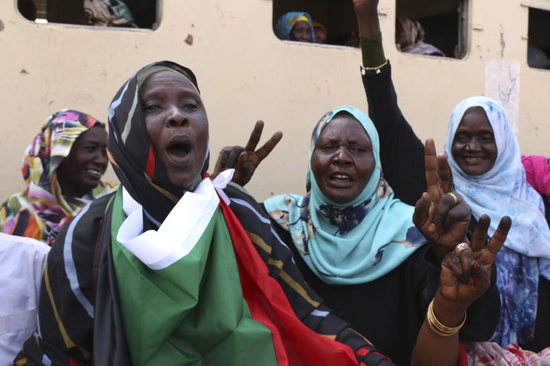 Sudanese pro-democracy supporters celebrate a final power-sharing agreement with the ruling military council Saturday, Aug 17, 2019, in the capital, Khartoum. The deal paves the way for a transition to civilian-led government following the overthrow of President Omar al-Bashir in April. (AP Photo)