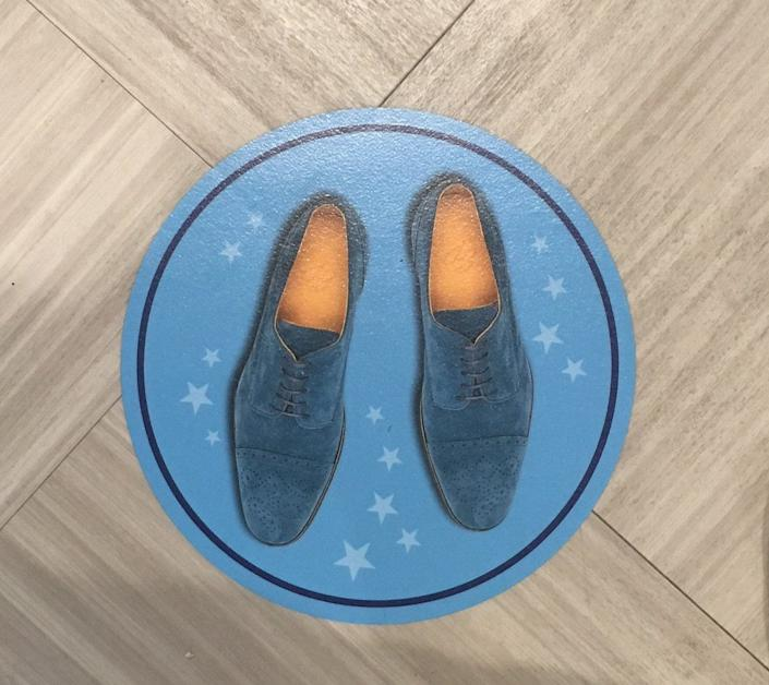 Blue suede shoe social distancing markers have been added to the floor of the Graceland welcome center.