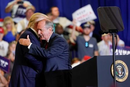 North Carolina's 9th District Republican candidate Dan Bishop hugs U.S. President Donald Trump during a campaign rally in Fayetteville, North Carolina