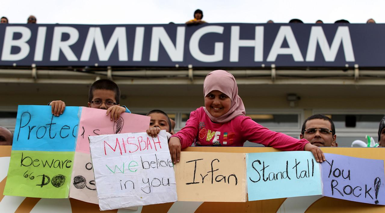Young Pakistan fans watch game against South Africa with hand written messages for Pakistan bowler Muhammad Irfan during the ICC Champions Trophy match at Edgbaston, Birmingham.