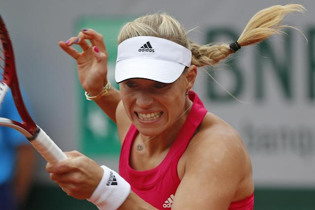 Germany's Angelique Kerber returns the ball during the fourth round match of the French Open tennis tournament against Canada's Eugenie Bouchard at the Roland Garros stadium, in Paris, France, Sunday, June 1, 2014. (AP Photo/Michel Euler)