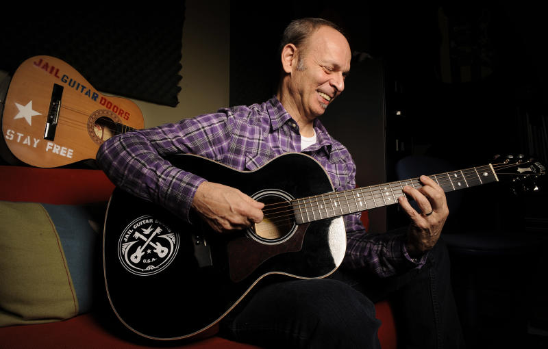 In this Jan. 16, 2012 photo, guitarist Wayne Kramer, founder of the band the MC5, plays one of the instruments that will be provided to jail inmates as part of the Jail Guitar Doors USA initiative at his recording studio in Los Angeles. The Jail Guitar Doors program provides instruments to inmates who are using music as a means of achieving rehabilitation. (AP Photo/Chris Pizzello)
