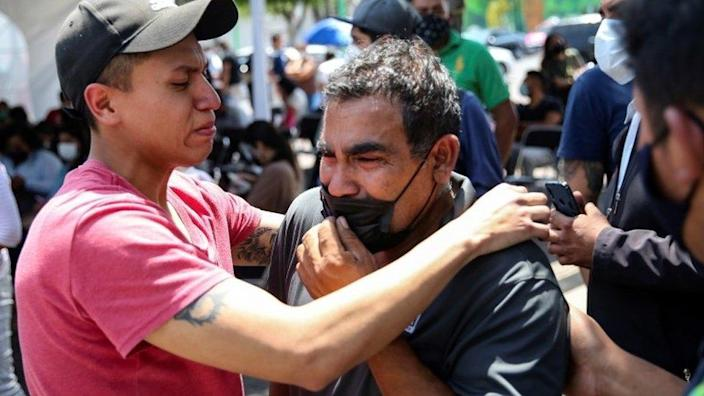Relatives of the victims react outside the Prosecutors Office in Iztapalapa neighbourhood, after an overpass of the metro partially collapsed with train cars on it, in Mexico City