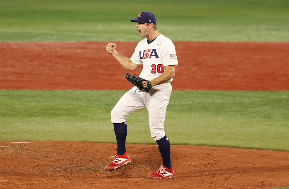 <p>YOKOHAMA, JAPAN - JULY 31: David Robertson #30 of Team United States celebrates winning the game 4-1 during the baseball opening round Group B game between Team South Korea and Team United States on day eight of the Tokyo 2020 Olympic Games at Yokohama Baseball Stadium on July 31, 2021 in Yokohama, Kanagawa, Japan. (Photo by Yuichi Masuda/2021 Getty Images)</p>