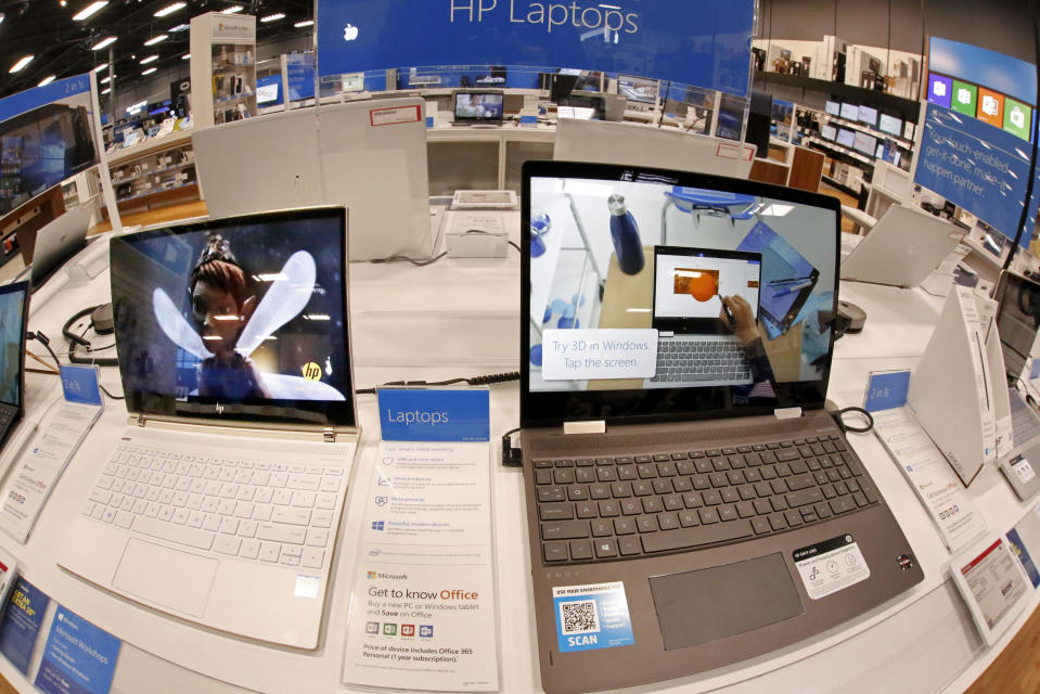 This Thursday, Feb. 22, 2018 photo shows a display of Hewlett Packard laptop computers in a Best Buy store in Pittsburgh. (AP Photo/Gene J. Puskar)