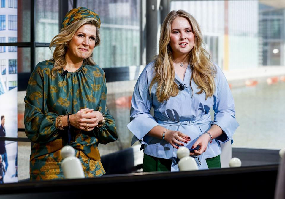 Dutch Queen Maxima (L) and her daughter Amalia sit in the studio of the High Tech Campus, in Eindhoven, on April 27, 2021 during the eighth edition of King's Day. - As many Dutch donned orange to celebrate King's Day, a public holiday to celebrate the monarch's birthday, the Ipsos poll found that confidence in King Willem-Alexander dove from 76 percent in April last year, to 57 percent, a study said on April 27, 2021.  - Netherlands OUT (Photo by Koen van Weel / ANP / AFP) / Netherlands OUT (Photo by KOEN VAN WEEL/ANP/AFP via Getty Images)