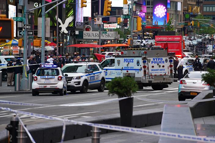Police officers respond to the scene of a shooting in Times Square on May 8, 2021, in New York. (David Dee Delgado / Getty Images)