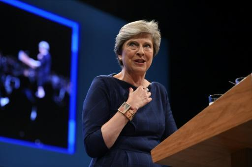 May warns 'ball in EU's court' as Brexit talks resume