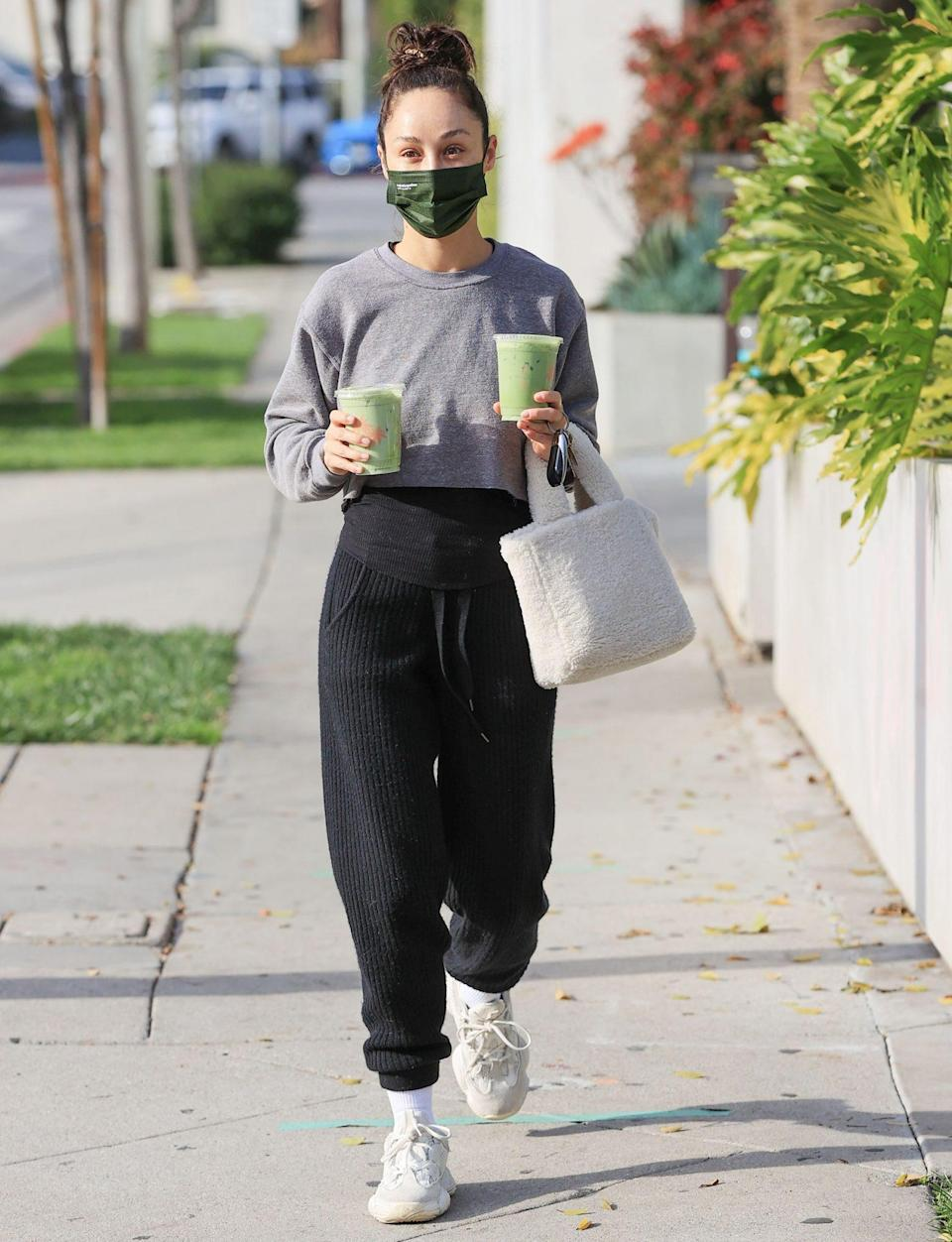 <p>Cara Santana doubles up on iced matchas from Cha Cha Matcha on Monday in West Hollywood. </p>