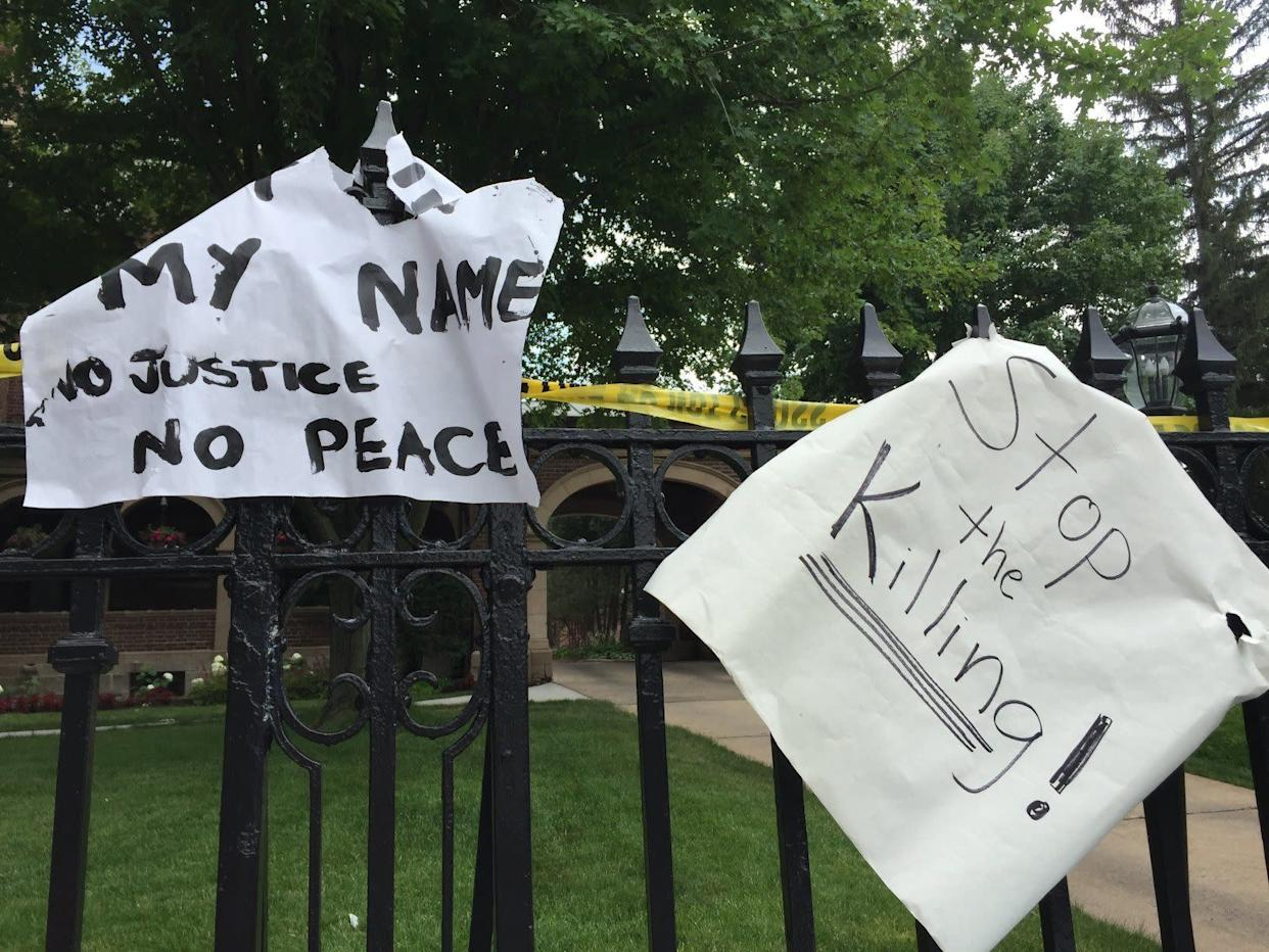 Signs outside the governor's mansion.