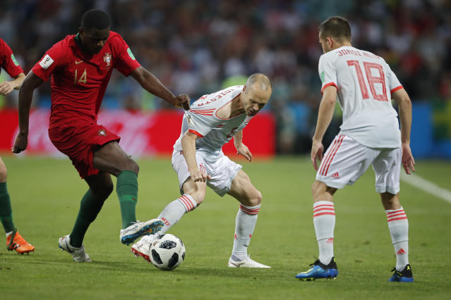 Portugal's William, left, and Spain's Andres Iniesta fight for the ball during the group B match between Portugal and Spain at the 2018 soccer World Cup in the Fisht Stadium in Sochi, Russia, Friday, June 15, 2018. (AP Photo/Francisco Seco)