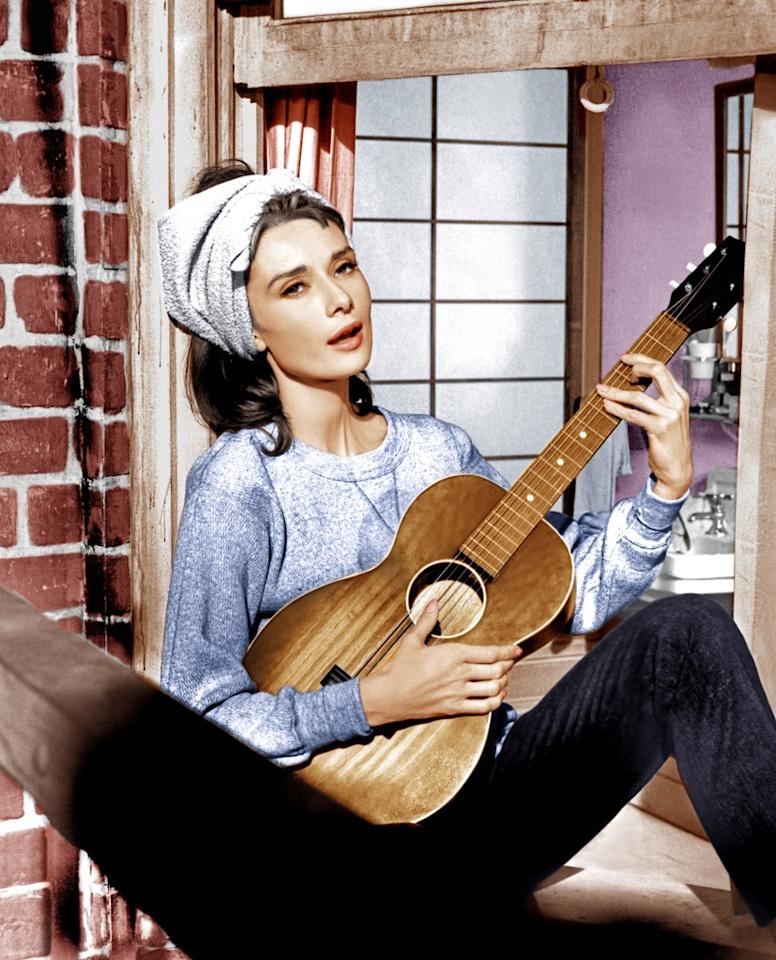 """""""Moon River"""" from """"Breakfast at Tiffany's"""" (1961): When Audrey Hepburn sings it alone on the fire escape of her Manhattan apartment, it's intimate, sweet and plaintive, an indication of the insecure woman looking for love that she tries to suppress through her glamorous persona and wild nights. When it swells during the film's climactic conclusion — in an alley in the pouring rain, as Hepburn finds the cat she cast aside and clutches it to her chest while giving George Peppard a passionate kiss — it's heartbreaking. I cry every time in a matter of seconds. Henry Mancini and Johnny Mercer — they did not screw around. (Chevy Chase also felt prompted to belt out this song during an especially thorough doctor's exam in """"Fletch."""")"""