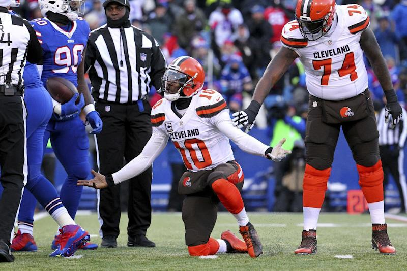 FILE - In this Dec. 18, 2016, file photo, Cleveland Browns quarterback Robert Griffin III (10) reacts after being sacked by Buffalo Bills defensive end Shaq Lawson (90) during the second half of an NFL football game, in Orchard Park, N.Y. A person familiar with the decision says the Browns are releasing quarterback Robert Griffin III after one injury-marred season. Griffin is being let go one day before he would have been due a $750,000 roster bonus, said the person who spoke Friday, March 10, 2017, to the Associated Press on condition of anonymity because the team has not announced the move. (AP Photo/Bill Wippert, File)