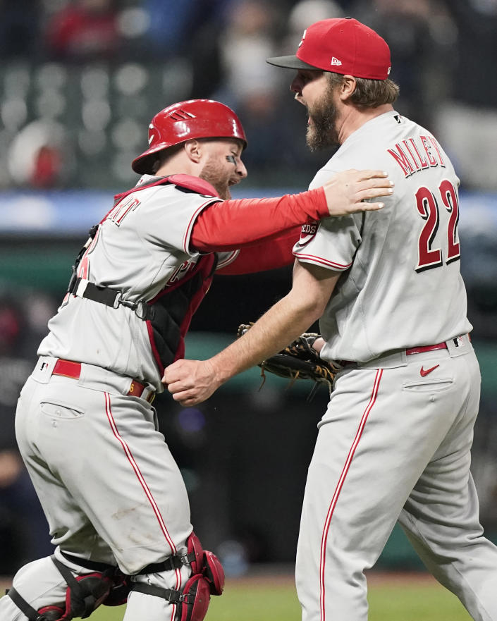 Cincinnati Reds starting pitcher Wade Miley, right, is congratulated by catcher Tucker Barnhart after pitching a no-hitter against the Cleveland Indians in a baseball game, Friday, May 7, 2021, in Cleveland. (AP Photo/Tony Dejak)