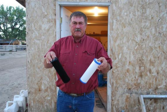 Jeff Locker, a Wyoming farmer, displays water filters from his well on September 17, 2009.