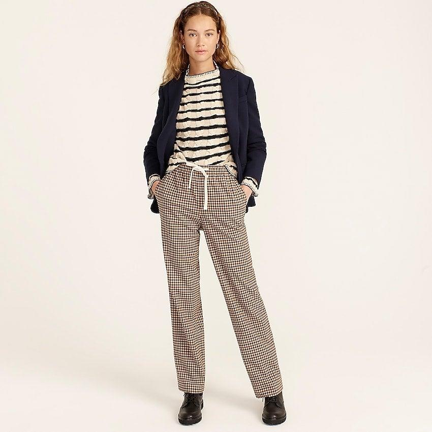 """<br><br><strong>J. Crew</strong> Tie-waist straight-leg pant in grey plaid Italian wool, $, available at <a href=""""https://go.skimresources.com/?id=30283X879131&url=https%3A%2F%2Fwww.jcrew.com%2Fp%2Fwomens%2Fcategories%2Fclothing%2Fpants%2Frelaxed%2Ftie-waist-straight-leg-pant-in-grey-plaid-italian-wool%2FBA237%3Fdisplay%3Dsale%26fit%3DClassic%26isFromSale%3Dtrue%26color_name%3Dhoney-brown%26colorProductCode%3DBA237"""" rel=""""nofollow noopener"""" target=""""_blank"""" data-ylk=""""slk:J. Crew"""" class=""""link rapid-noclick-resp"""">J. Crew</a>"""