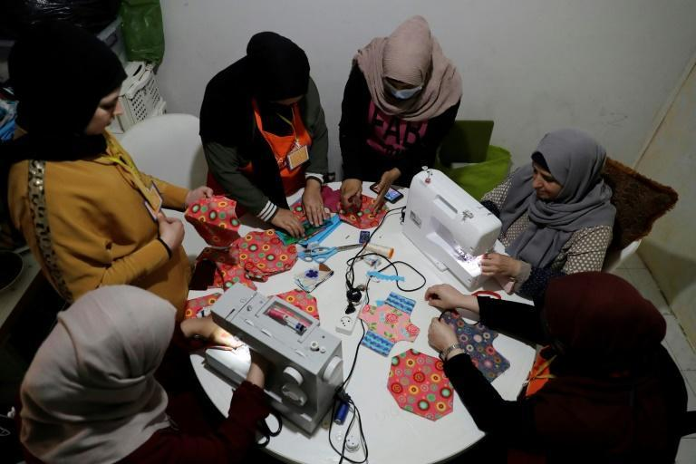 Members of international NGO Days For Girls and local partner WingWoman Lebanon train refugee women to make reusable sanitary pads out of colourful cloth in Beirut's Shatila Palestinian refugee camp