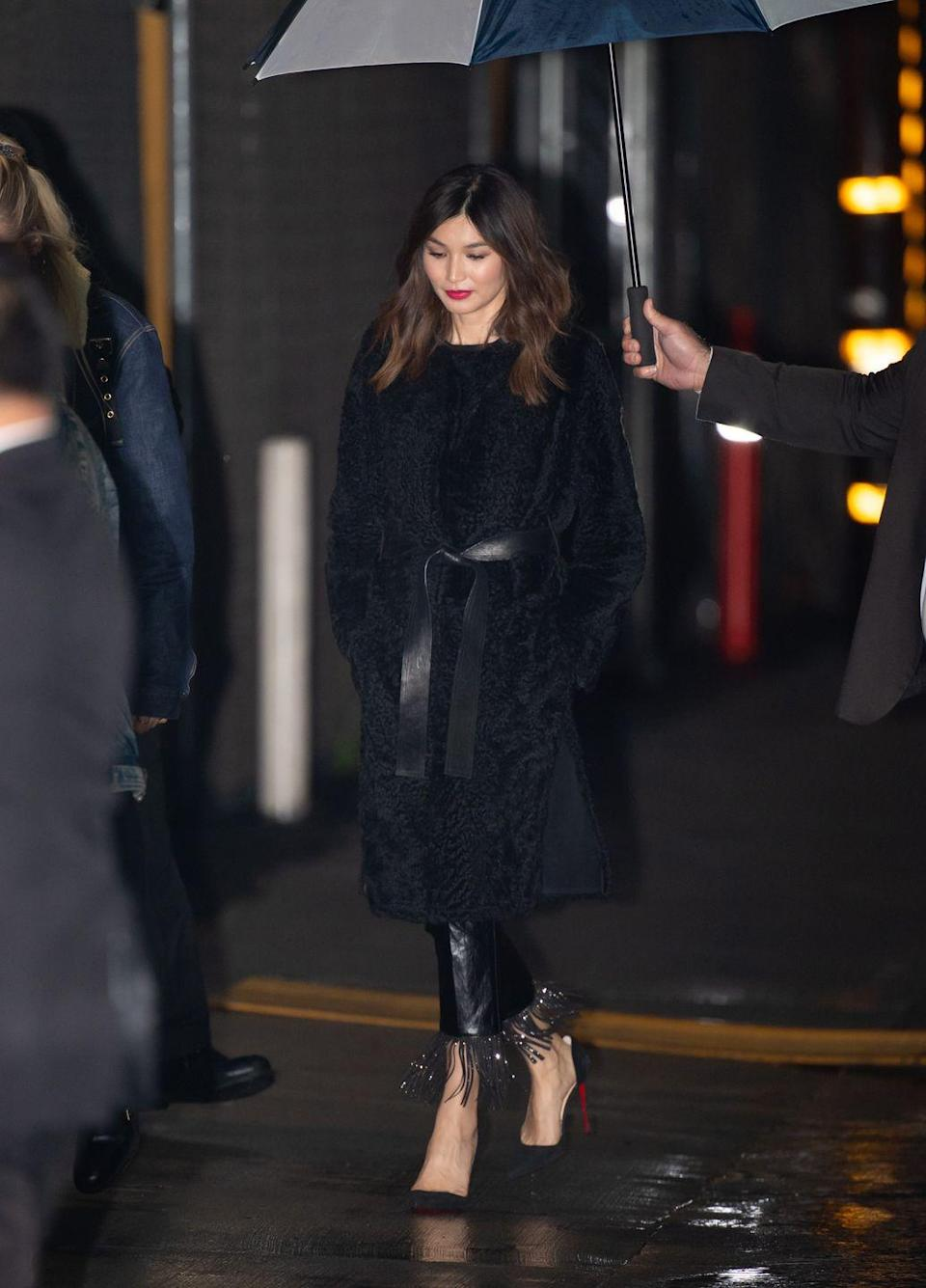 <p>Gemma Chan was spotted in Los Angeles in a sleek all-black ensemble. The actress wore a tasselled leather wide legged trouser, plain suede Christian Louboutins in black and blocked out the chill with a cinched black coat. </p>