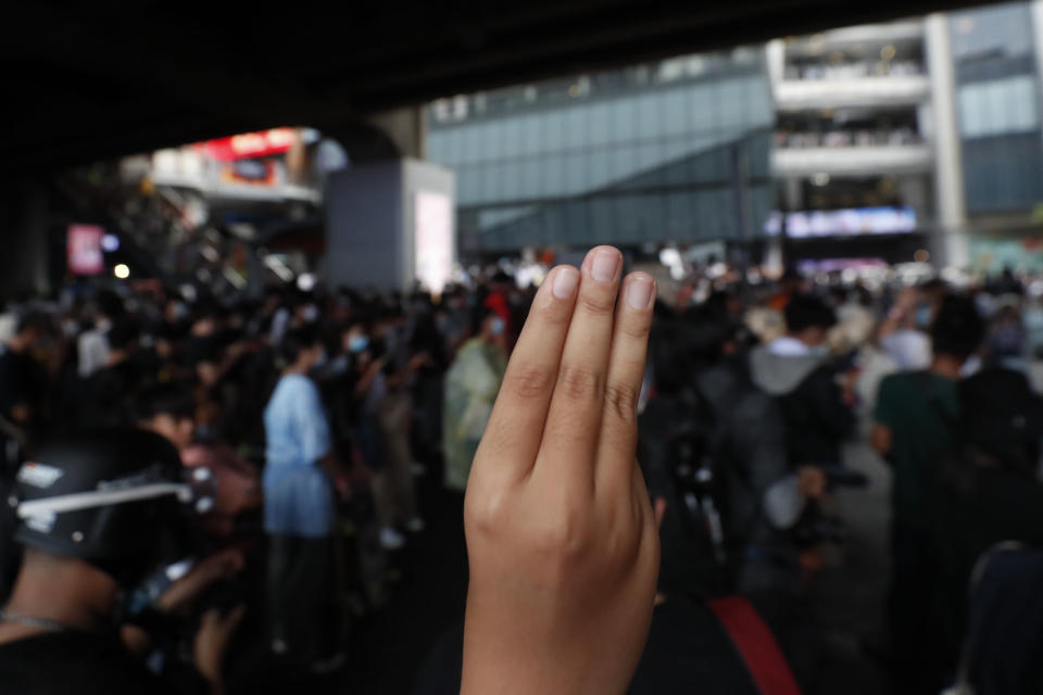 "The three-finger protest gesture is flashed during a student rally in Bangkok, Saturday, Nov. 21, 2020. Organized by a group that mockingly calls themselves ""Bad Students,"" the rally calls for educational reforms and also supports the broader pro-democracy movement's demands for constitutional change. (AP Photo/Sakchai Lalit)"