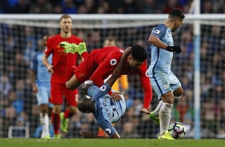 Manchester City's Fernandinho in action with Liverpool's Emre Can