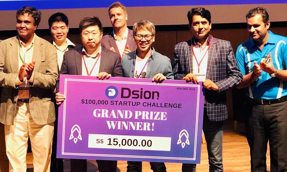 Beam And Go CEO Jonathan Chua (centre) receiving the top prize at the inaugural Dsion Startup Challenge from Dsion CEO Seo Jong-pil (left) and Block On Capital chairman Jagdish Pandya. (PHOTO: Dsion Startup Challenge)