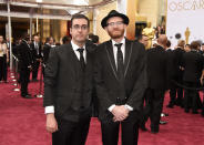 """FILE - Filmmaker Tomm Moore, left, and Paul Young, nominated for """"Song of the Sea,"""" arrive at the Oscars in Los Angeles on Feb. 22, 2015. This year Moore, along with co-director Ross Stewart are nominated for an Oscar for best animated feature for """"Wolfwalkers."""" The film was produced by Young. (Photo by Chris Pizzello/Invision/AP, File)"""