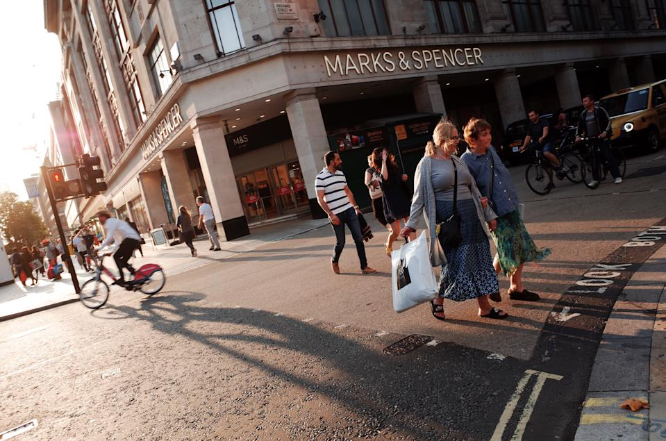 Shoppers cross a junction in front of a branch of clothing and food retailer Marks and Spencer on Oxford Street in London, England, on September 16, 2020. While the UK continues to edge towards economic recovery some 3,991 new coronavirus cases were recorded today, in what is the highest daily figure in the country since May 8. Prime Minister Boris Johnson meanwhile today told a parliamentary committee that he did not want a second national lockdown as part of the ongoing response to the covid-19 crisis. (Photo by David Cliff/NurPhoto via Getty Images)