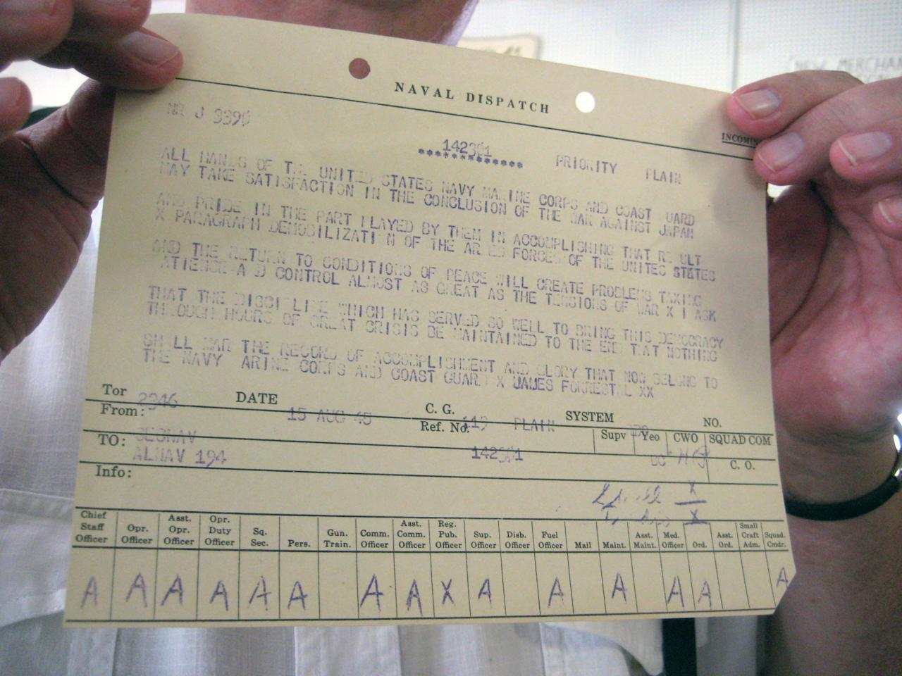 Bob York displays a naval dispatch announcing V-J Day, the end of the war with Japan, at Col. Kirk's Auction Gallery in Millville, Pa., Aug. 6, 2012. York is auctioning the rare cable on Aug. 15, the 67th anniversary of V-J Day. (AP Photo/Michael Rubinkam)