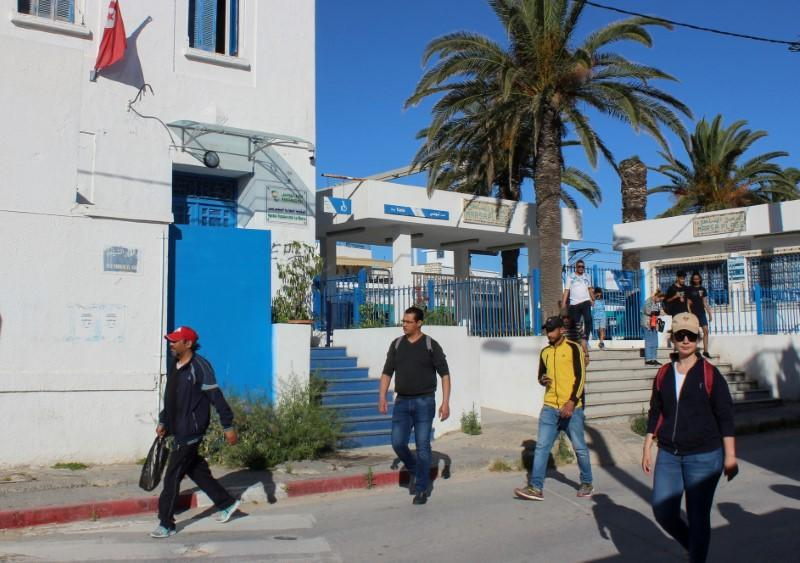 FILE PHOTO: People leave a train station, as Tunisia relaxes some of its lockdown rules while keeping other restrictions in place, as preventive measures against the spread of the coronavirus disease (COVID-19), in La Marsa near Tunis