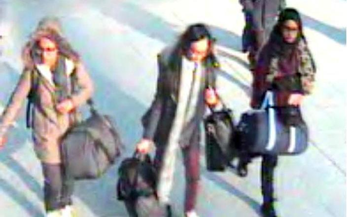 Ms Begum, right, was 15 when she and two other east London schoolgirls travelled to Syria in 2015 - Metropolitan Police
