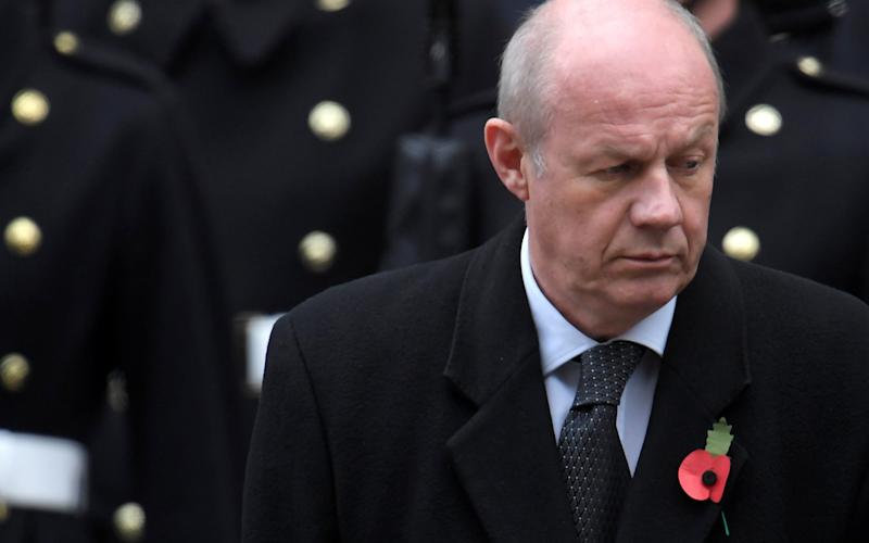 Damian Green stands in silence at the Remembrance Sunday Cenotaph service in London - REUTERS
