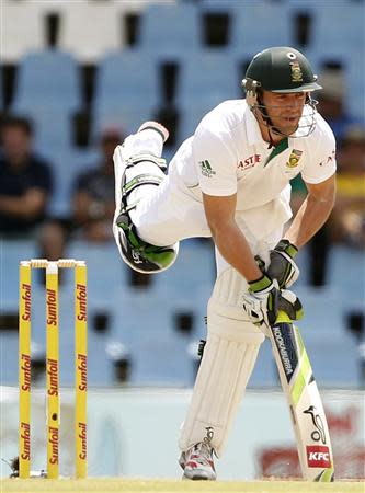 South Africa's AB de Villiers reacts after playing a shot during the third day of their cricket test match against Australia in Centurion February 14, 2014. REUTERS/Siphiwe Sibeko