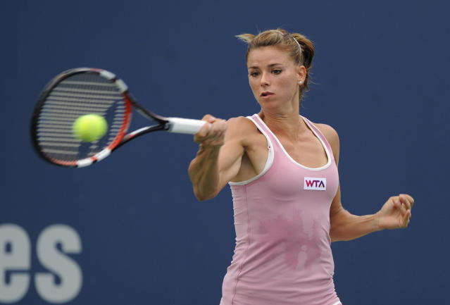Camila Giorgi, of Italy, hits a forehand during a quarterfinal match against Garbine Muguruza, of Spain, at the New Haven Open tennis tournament in New Haven, Conn., Thursday, Aug. 21, 2014. (AP Photo/Fred Beckham)
