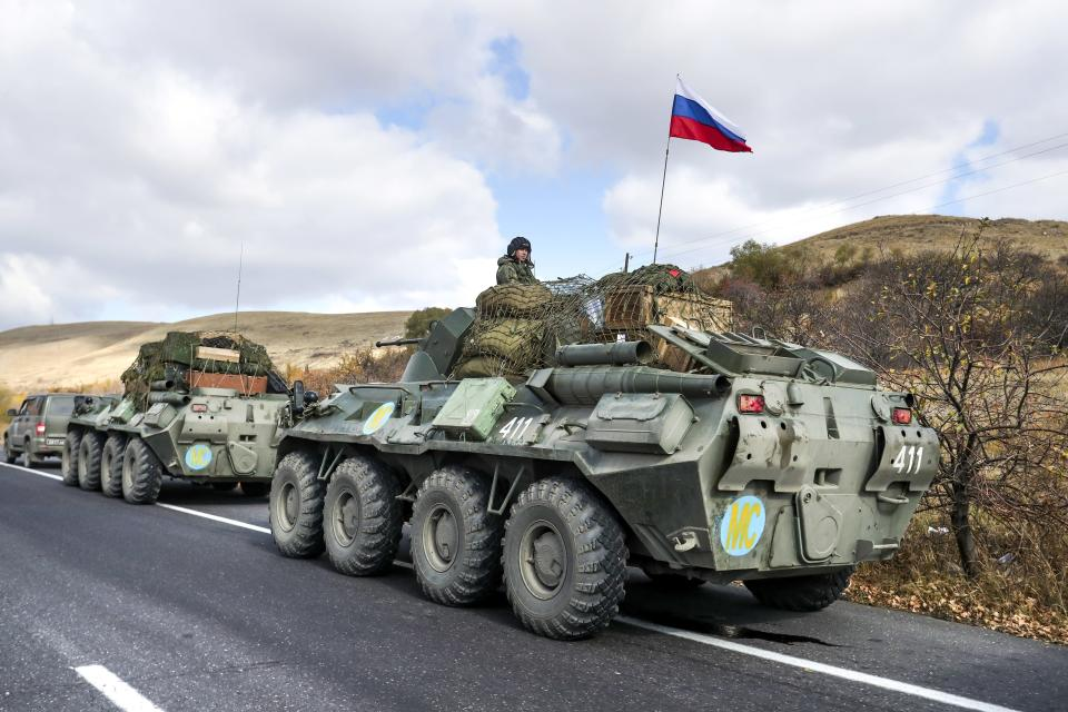 FILE In this file photo taken on Friday, Nov. 13, 2020, Russian military vehicles parked on the road near Seven lake, Armenia, towards the separatist region of Nagorno-Karabakh. Acting Prime Minister Nikol Pashinyan called the vote after months of mass protests demanding his resignation over his handling of the conflict. A Russia-brokered peace deal signed in November ended six weeks of fighting between Armenian and Azerbaijani forces that killed 6,000 people. (Hayk Baghdasaryan/PHOTOLURE via AP, File)