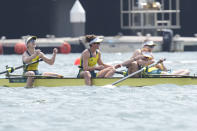 Lucy Stephan, Rosemary Popa, Jessica Morrison and Annabelle McIntyre of Australia celebrate after winning the gold medals in the women's rowing four final at the 2020 Summer Olympics, Wednesday, July 28, 2021, in Tokyo, Japan. (AP Photo/Lee Jin-man)